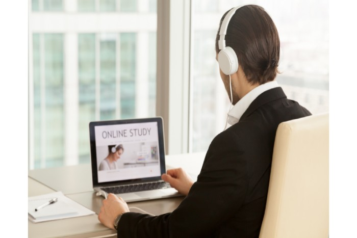 start studying now: man with a headset studying online